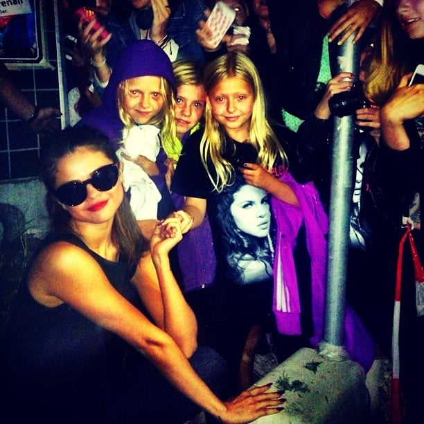 Selena Gomez posed with a group of pint-sized fans after one of her concerts. Source: Instagram user selenagomez