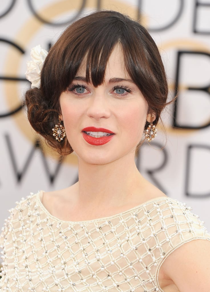 Zooey Deschanel added to her dress's charm with a pair of Neil Lane pearl, citrine and platinum flower earrings.