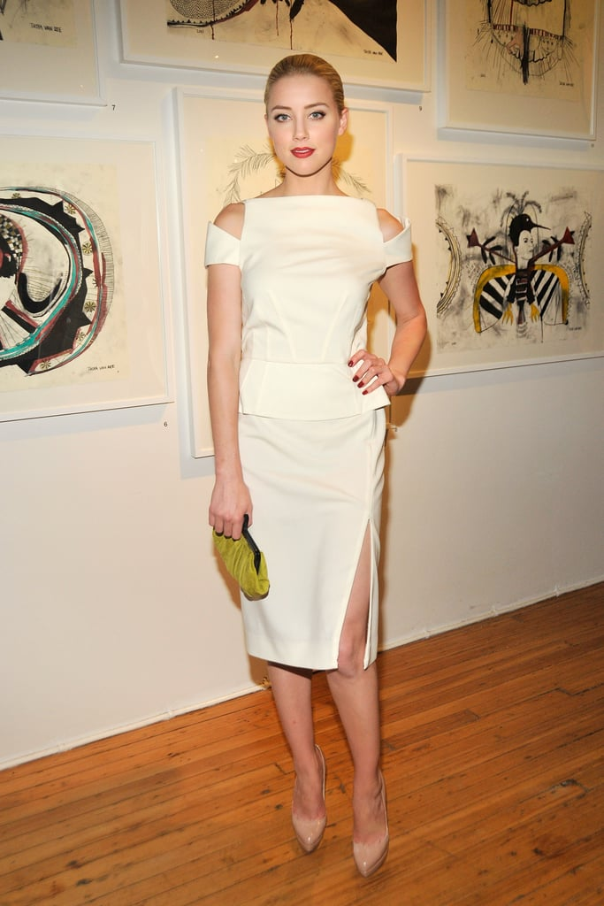At an art party in NYC in June 2011, Amber was sultry in a white cutout dress with a sexy thigh-high slit.