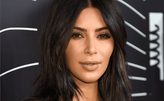 Kim Kardashian Completely Switches Up Her Look With Blond Hair and a Dark Wine-Red Lip