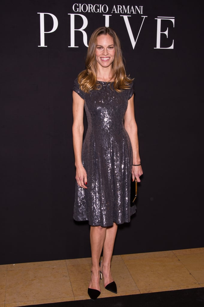 Hilary Swank got glittery in a sequin gray knee-length dress and d'Orsay pumps for Giorgio Armani.