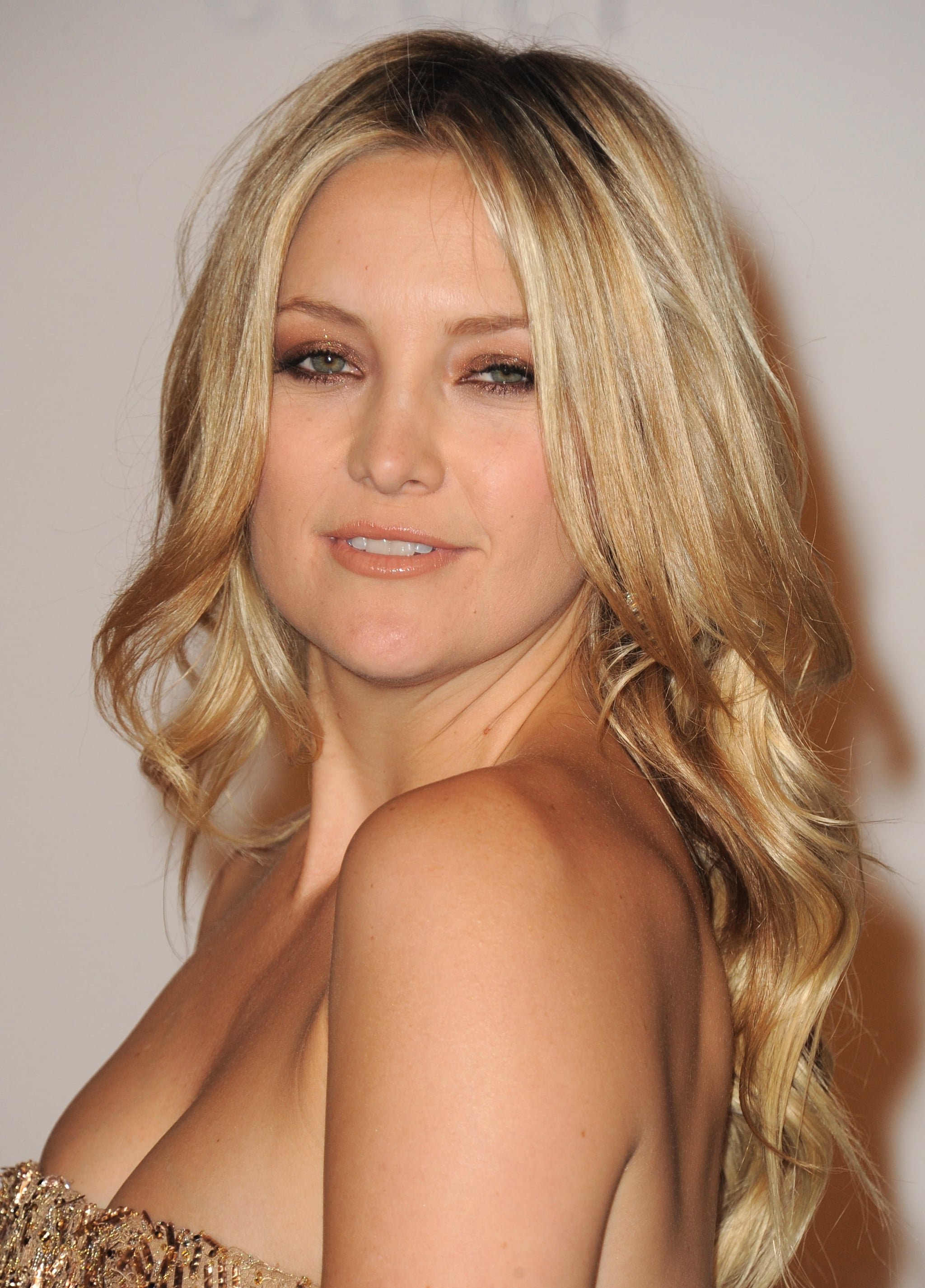 Kate Hudson in a strapless gold dress.