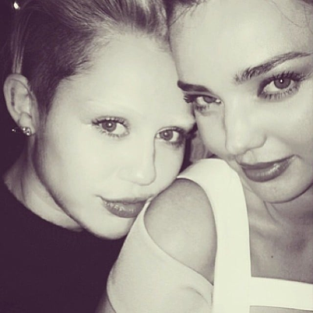 An eyebrow-less Miley Cyrus shared a selfie with Miranda Kerr. Source: Instagram user mileycyrus