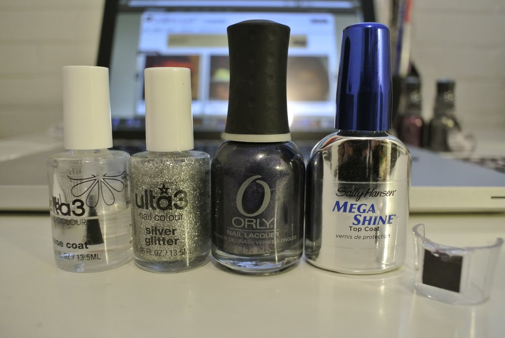 I used Ulta3 Base Coat, Ulta3 Silver Glitter, Orly Magnetic FX Nail Polish in Opposites Attract and Sally Hansen Mega Shine Top Coat. The little plastic piece to the far right is the magnet that comes attached to each polish. Each colour has a different magnet and creates a different pattern. The one I'm using creates a cross of sorts.  Paint On Electron (silver) creates a zig-zag and Force Field (burgundy) creates a graduation of lines down the nail. If you thought that was hard to describe, you're right!