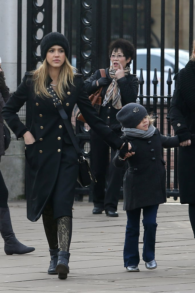 Could Jessica Alba's military-inspired London look get any chicer? We love the long double-breasted Ferragamo coat, black ankle boots, knit beanie.