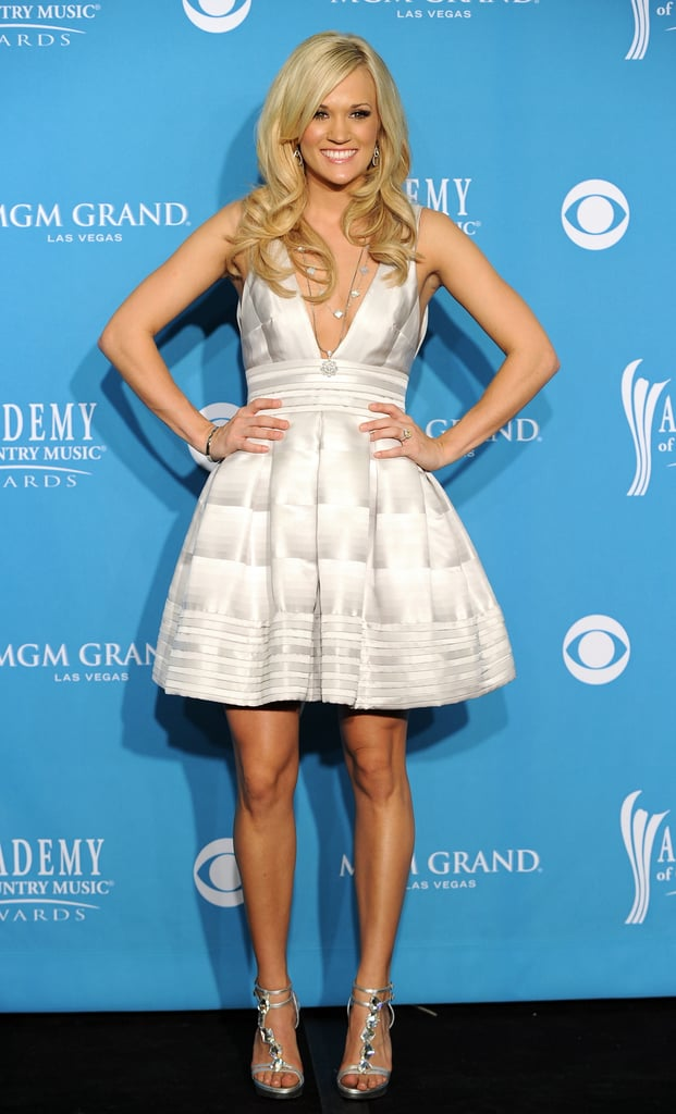 In 2008, Carrie worked a gradient Rafael Cennamo full-skirt mini in the Academy of Country Music Awards press room.