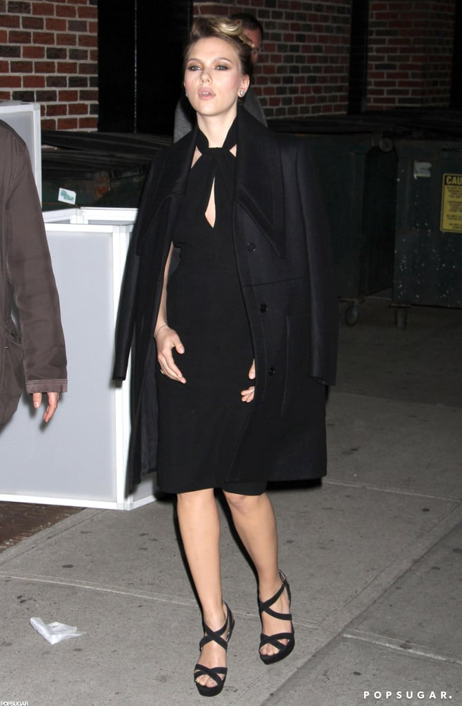 Scarlett Johansson wore a black cape over her dress for a visit to the The Late Show.