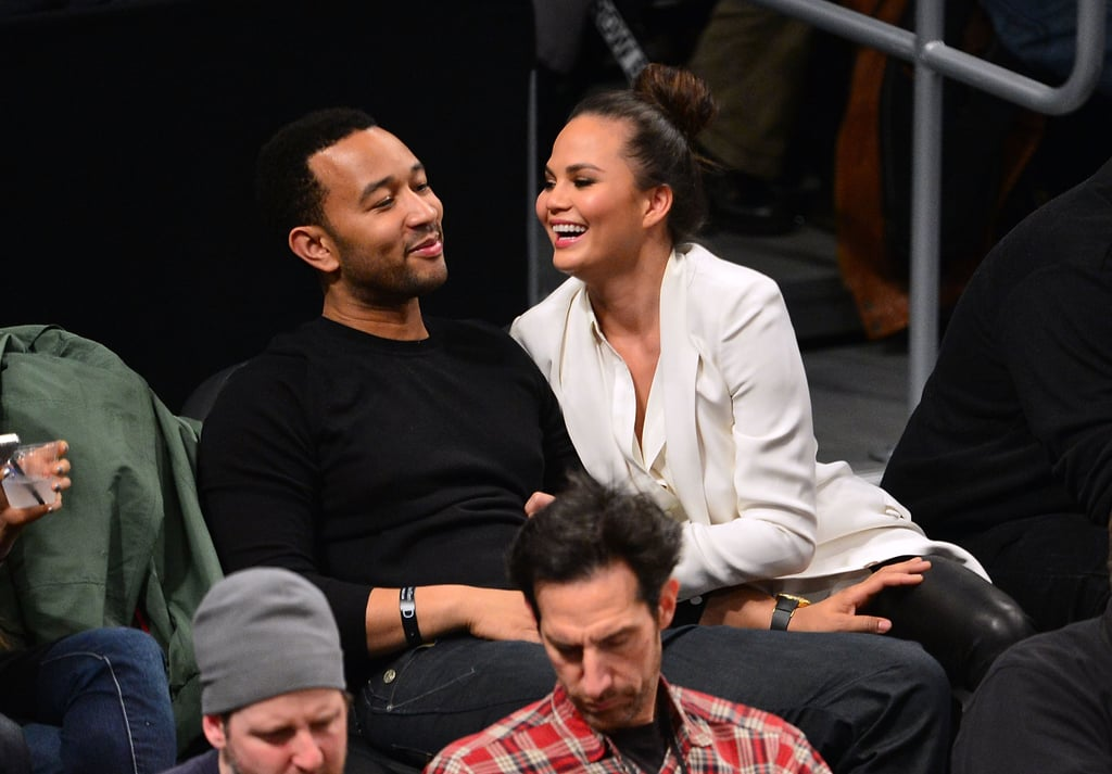 John Legend and Chrissy Teigen looked cute in the stands while watching the Lakers play the Brooklyn Nets in February 2013.