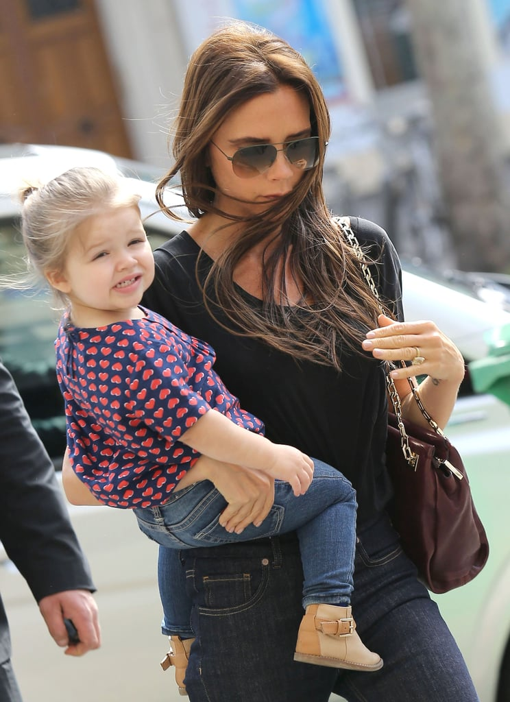 Harper Beckham smiled while out shopping with mom Victoria Beckham.