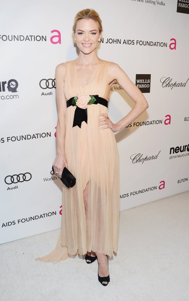 Jaime King wore a nude gown with a bow to Elton John's Oscar party in LA.