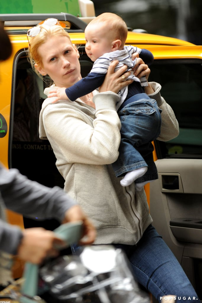 January Jones took baby Xander out of a cab in NYC.