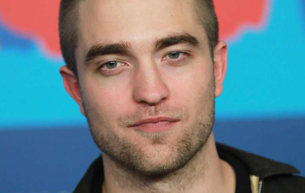 Handsome Rob gave a little smile for the cameras at the Bel Ami Press Conference.