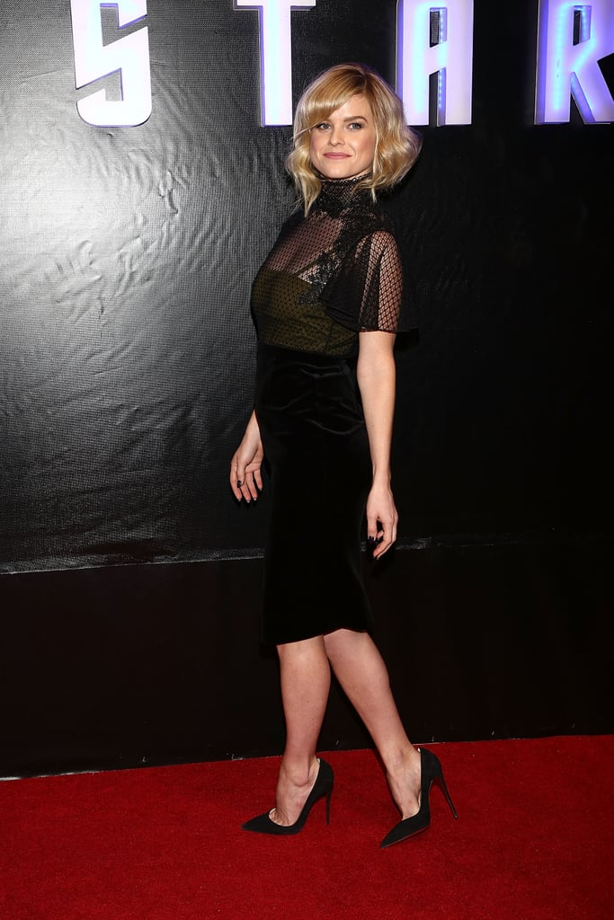 Alice Eve took a darker approach in a sheer black knee-length Gucci dress and black pointy pumps at the Mexico City premiere.