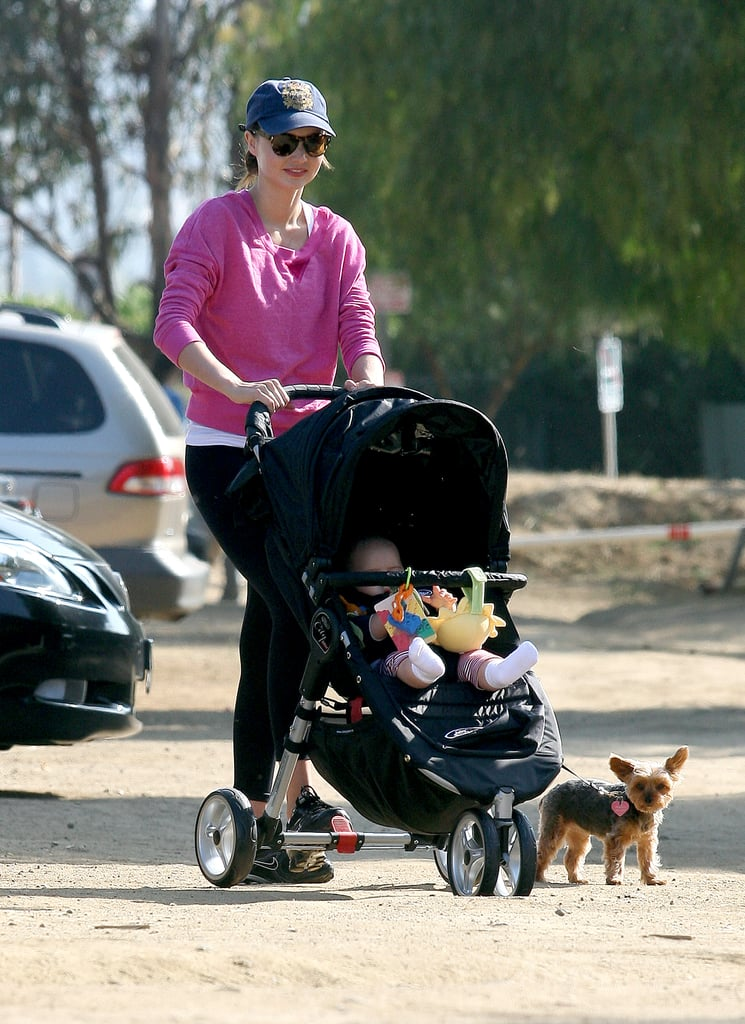 Miranda Kerr took Flynn and Frankie, their pup, for a walk around LA in June 2011.