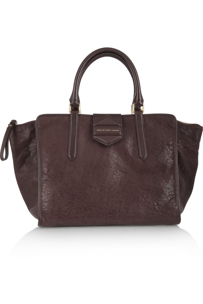 """""""I don't usually go for bigger tote silhouettes, but I couldn't resist this perfectly distressed leather texture in the richest Fall shade of brown. Plus, it will definitely hold my scarf, gloves, and hat without making me look like I do, in fact, carry my whole life around with me."""" — Marisa Tom, associate editor Marc by Marc Jacobs Flipping Out Textured-Leather Tote ($600)"""