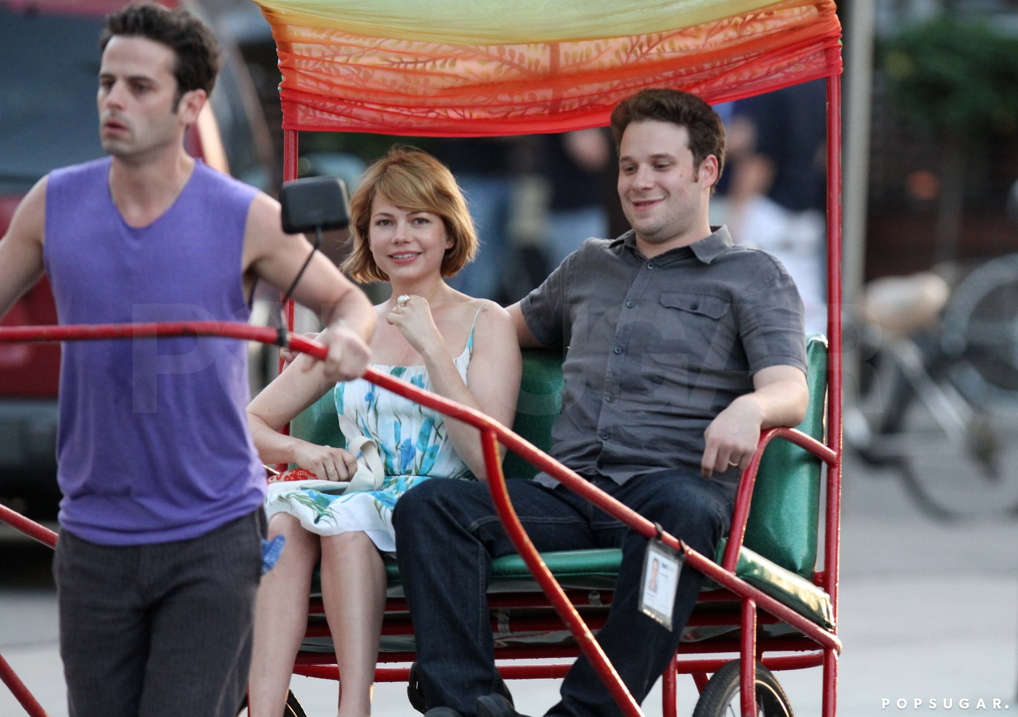 Seth Rogen and Michelle took a rickshaw ride together in August of 2010 while filming Take This Waltz on location.