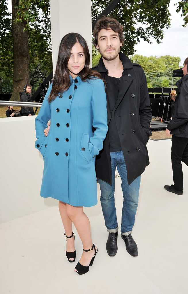 Julia Restoin-Roitfeld wore a brightly hued Burberry coat to the label's Spring show.