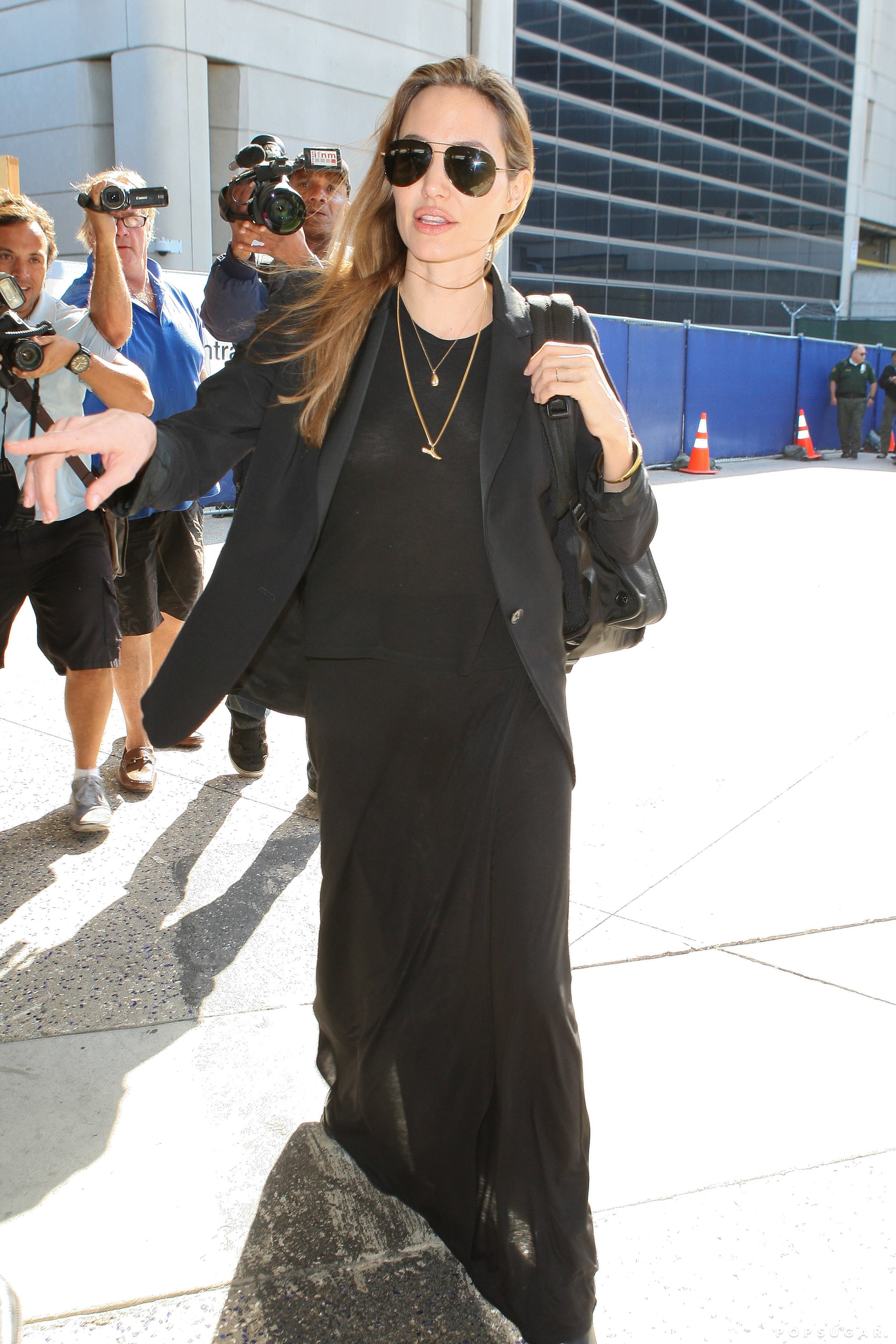 Angelina Jolie made her way through the crowd at LAX on Wednesday.
