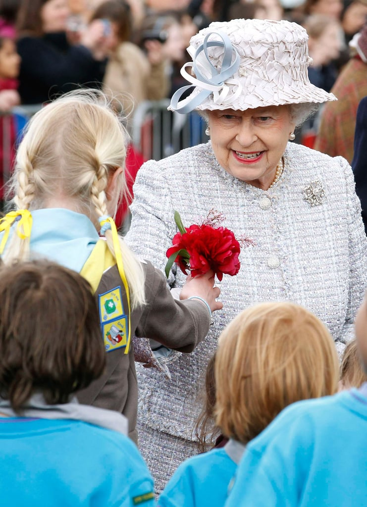 Queen Elizabeth II received flowers from a young well-wisher during a visit to the Wild London exhibition with Prince Philip, Duke of Edinburgh, on May 15 in Richmond, England.