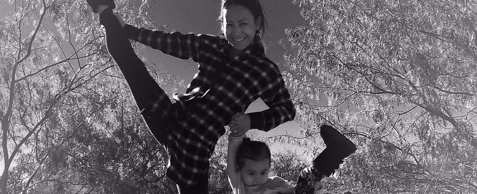 Watch This Mom Effortlessly Get Into Handstand With Her Daughter Balancing on Her Back