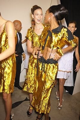Solid gold! The ladies weren't to be missed in their lamé sets.