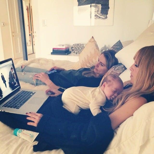 Rachel Zoe snuggled up with baby Kaius to watch the Oscar de la Renta show online. Source: Instagram user rachelzoe