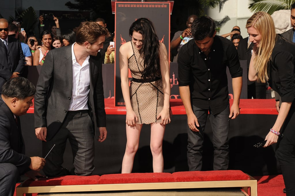 Robert, Kristen, and Taylor Put Their Prints in Cement!