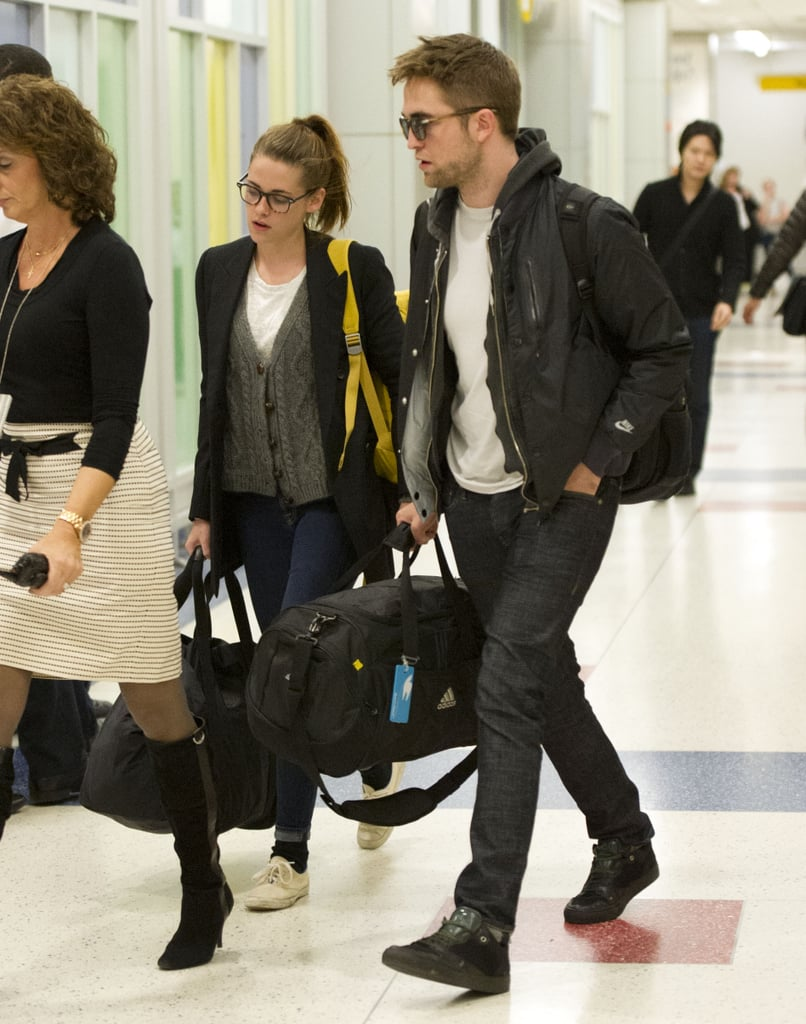 Kristen Stewart and Robert Pattinson confirmed that their relationship is going strong by returning to JFK airport together on November 24.