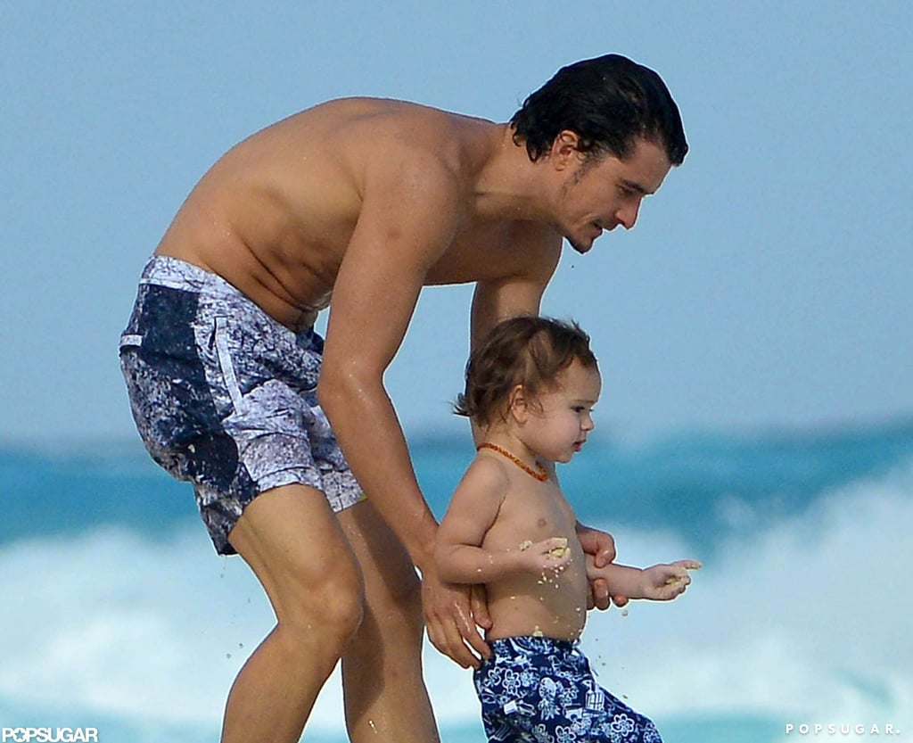 Shirtless Orlando Bloom Spends a Sweet Beach Day With Flynn