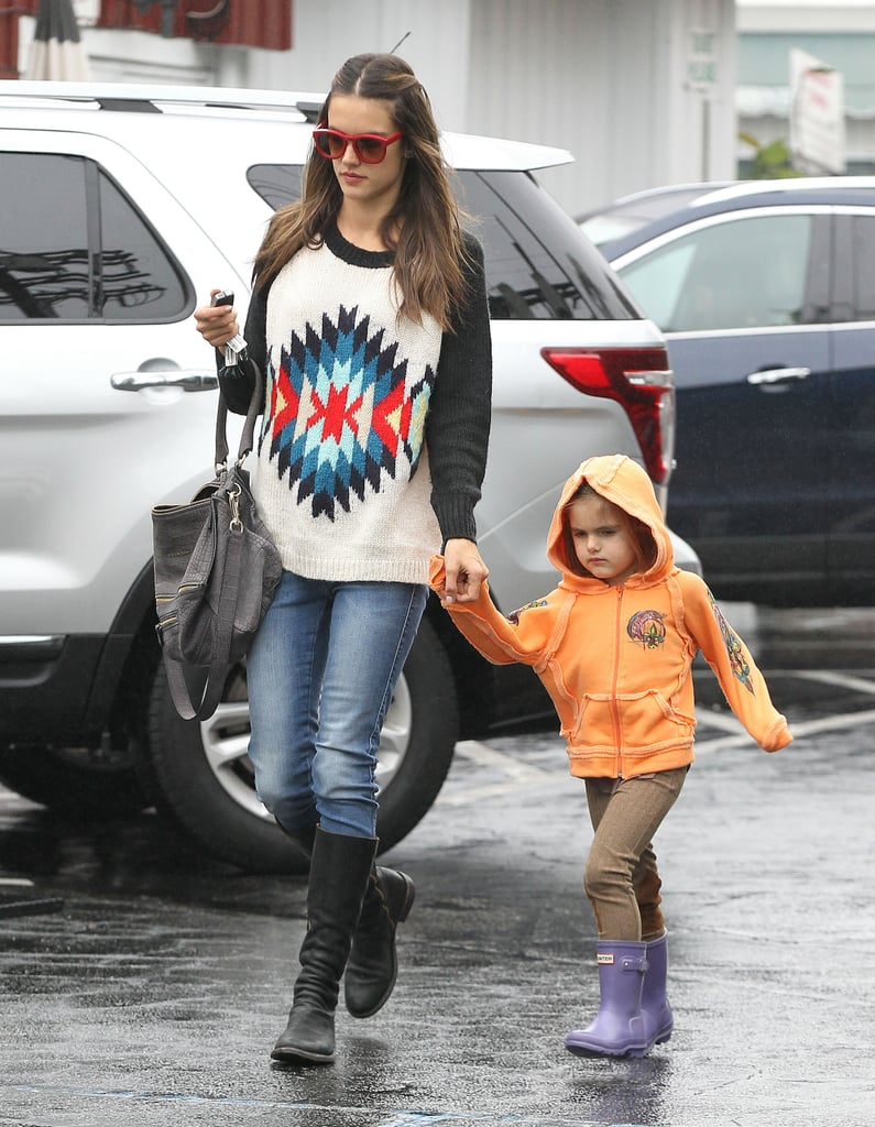 Alessandra Braves the Rain With Anja and Talks Up the VS Fashion Show