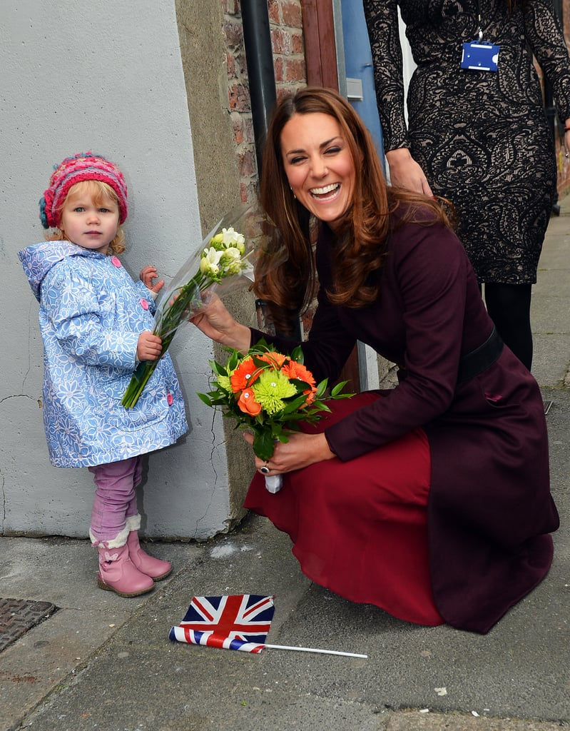 Kate couldn't stop laughing during her meeting with 2-year-old Lola Mackay at a British hospital in October 2012. When she got down to accept the little girl's bouquet of flowers, Lola decided she would rather keep them for herself!