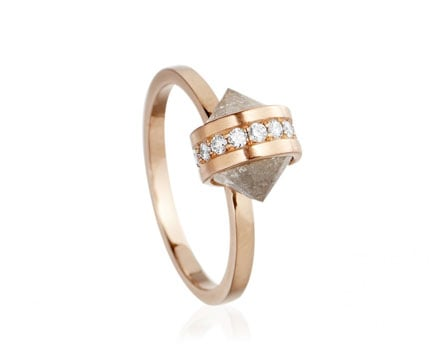 The slightly edgier feel of this geometric-inspired setting leads us to believe that this Katie Rowland Satori harmony halo ring ($5,400) is made for the girl who doesn't want just any old diamond ring.