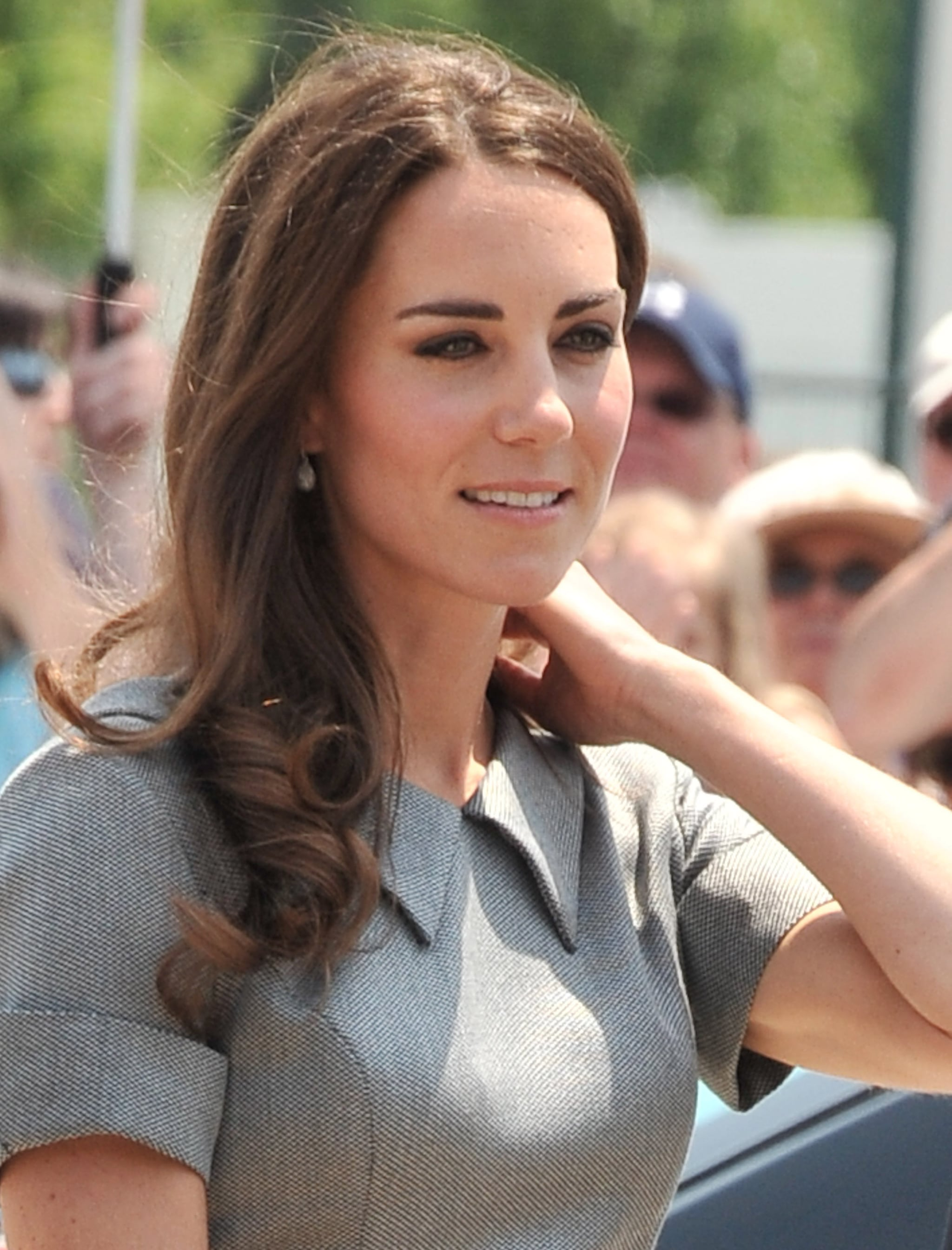 """July 2nd, 2011 Attending a tree planting ceremony in Ottawa, Canada.  Kate wears a grey Catherine Walker """"Kensington"""" dress and Links of London Hope Egg earrings."""