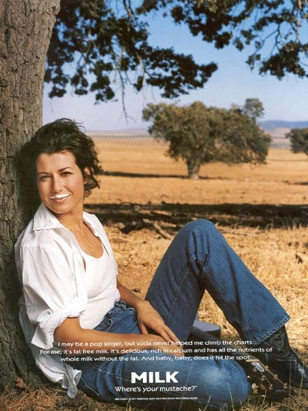 """""""Baby, Baby"""" singer Amy Grant's ad was set in a field, where she gave a dramatic gaze."""
