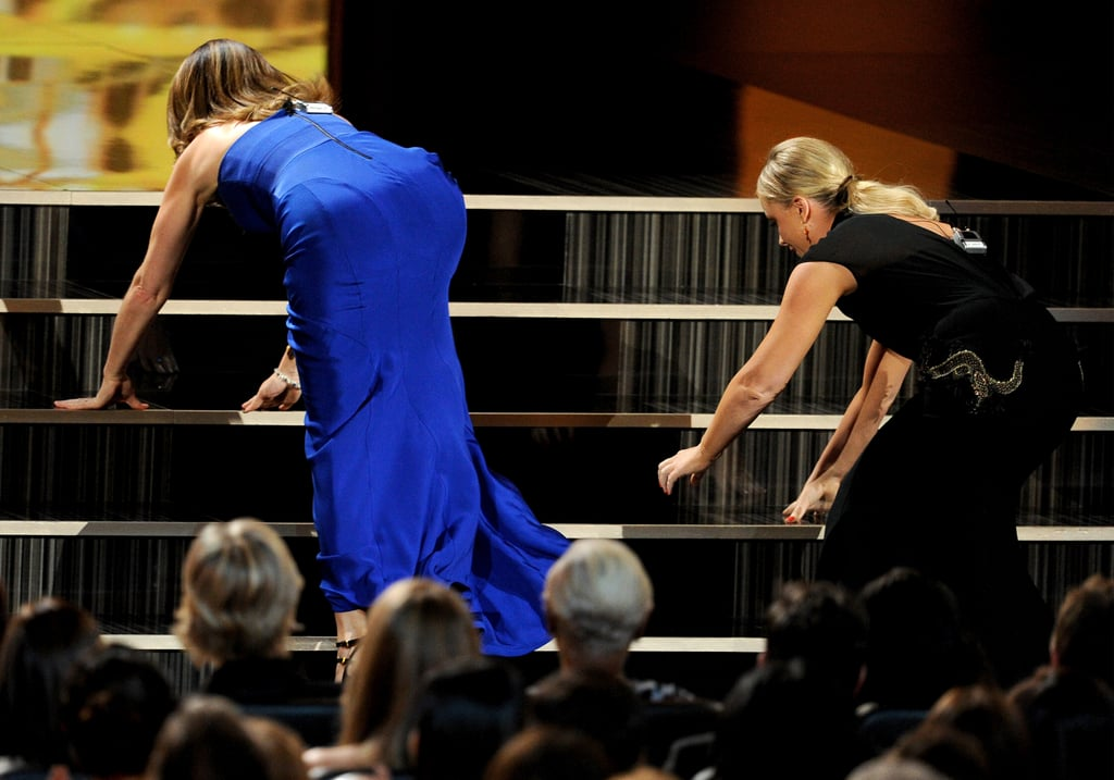 Tina Fey and Amy Poehler struggled to get up the stairs.