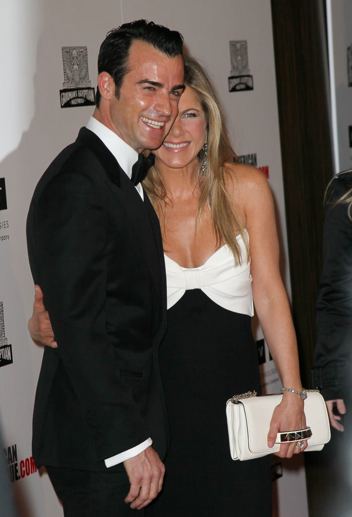 Jennifer Aniston carried a white clutch at the awards in LA.