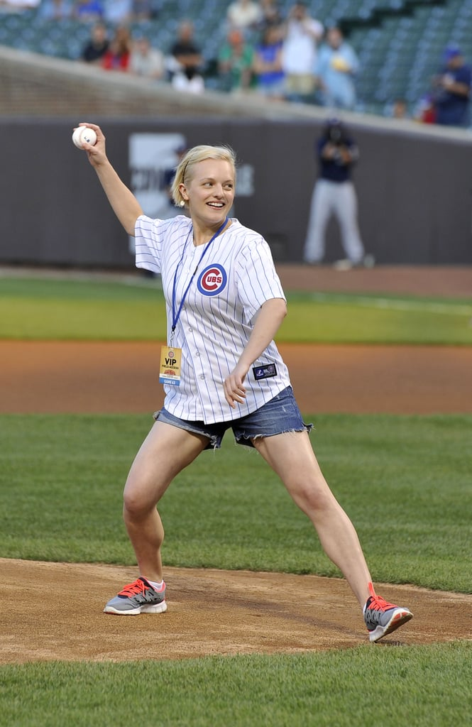 Elisabeth Moss threw out the first pitch for the Chicago Cubs in August 2012.
