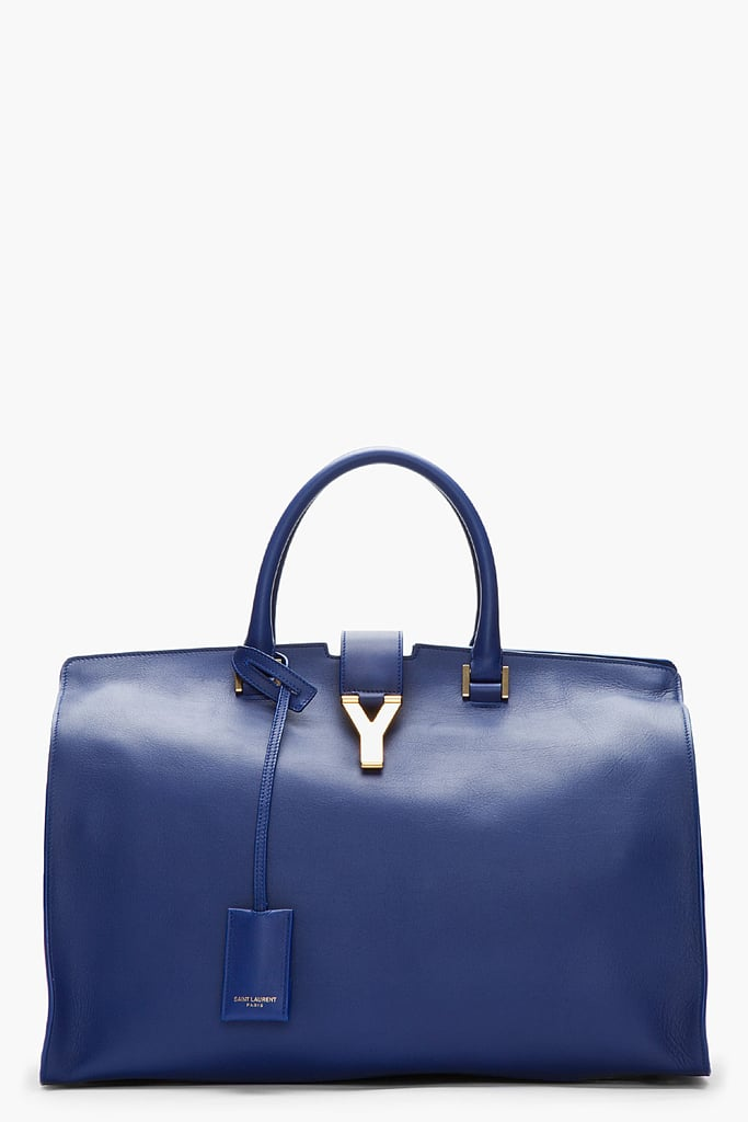 General wisdom might suggest that accessory investments be made strictly in terms of black or nude, but we beg to differ. An eternally gorgeous silhouette like Saint Laurent's leather tote ($2,950) feels even more luxurious in an inky navy.
