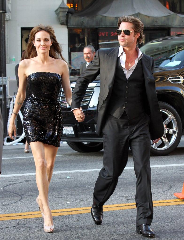 Brad Pitt held onto Angelina Jolie's hand arriving at her July 2010 LA premiere of Salt.