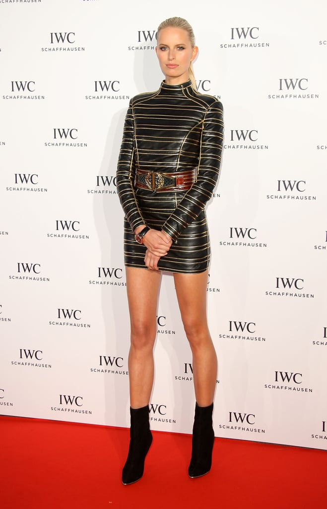 Karolína Kurková matched a black-and-gold leather Balmain minidress with black boots at the IWC dinner during the Cannes Film Festival.