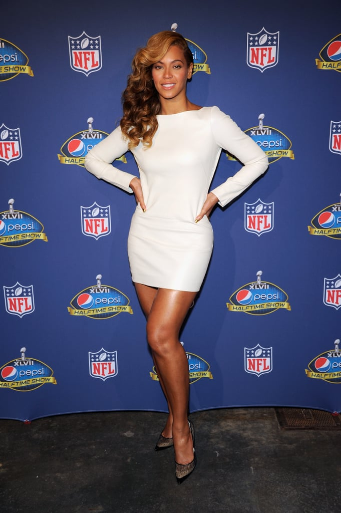 Beyoncé did right by a sexy white leather Olcay Gulsen minidress at the Pepsi Super Bowl halftime show press conference on Jan 31. Not letting any detail go to waste, she also sported sheer-mesh polka-dotted pumps, supplying a double dose of sexy-meets-sweet style.