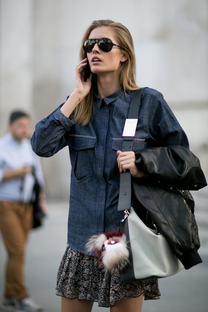 That Fendi fur ball is a dead giveaway — this girl's in fashion.