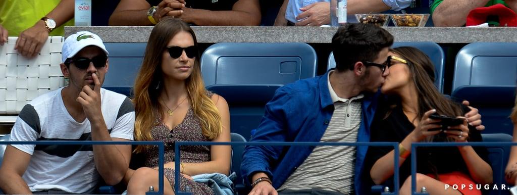 Nick Jonas and Joe Jonas watched the action with their girlfriends.