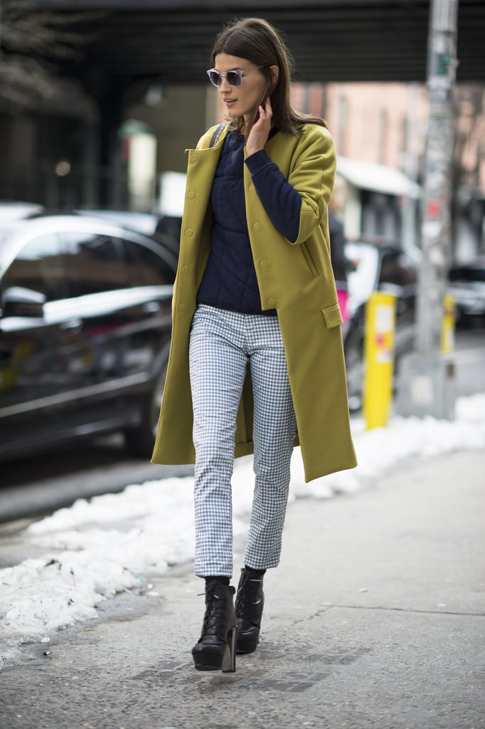 Hanneli Mustaparta kept it cool and classic in a pair of cropped, printed trousers and an understated but richly hued coat. Source: Le 21ème   Adam Katz Sinding
