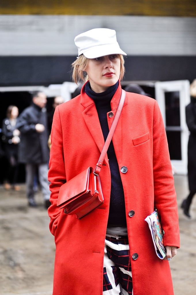 A sleek red bag was the perfect tone-on-tone complement to this street style look.