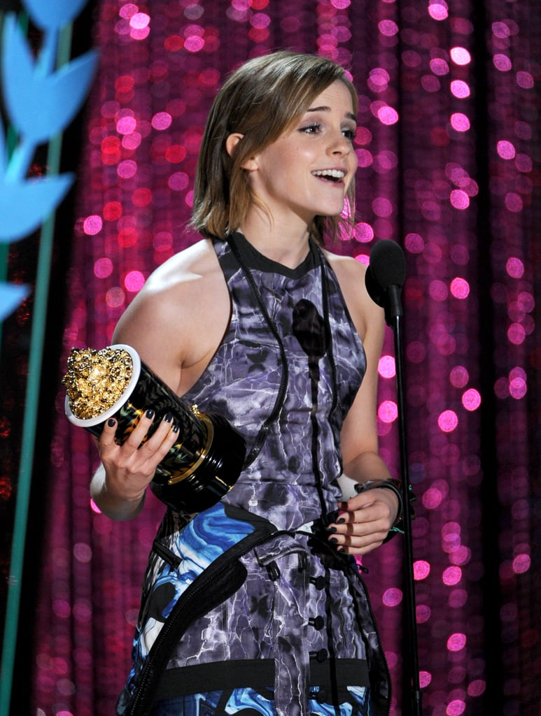 Emma Watson proudly accepted an MTV Movie Award statue.