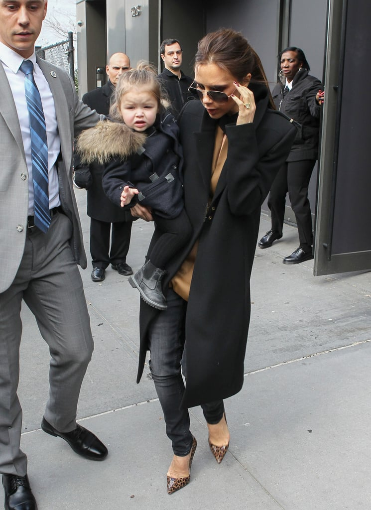Victoria Beckham carried Harper in NYC.