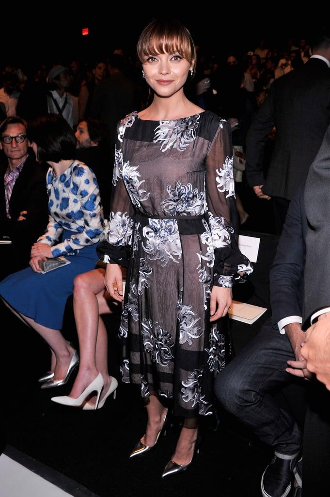 Christina Ricci dressed herself in a sheer floral dress and silver metallic pumps at Carolina Herrera.