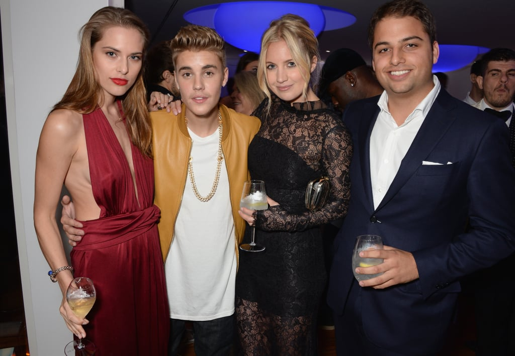 Justin Bieber got friendly with fellow partygoers, including model Lana Zakocela, fashion insider Marissa Montgomery, and Jamie Reuben.