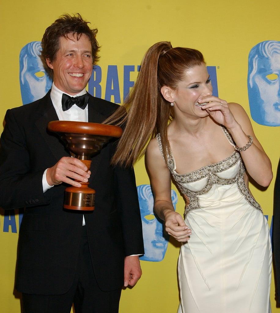 Hugh Grant and Sandra were full of laughs during LA's 12th Annual BAFTA/LA Britannia Awards in November 2003.